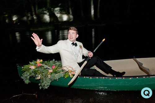 groom in wedding canoe